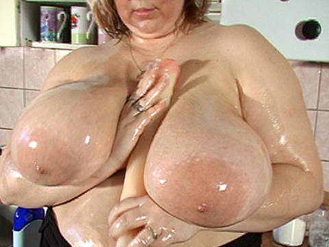 Huge boobs rubbing dildo