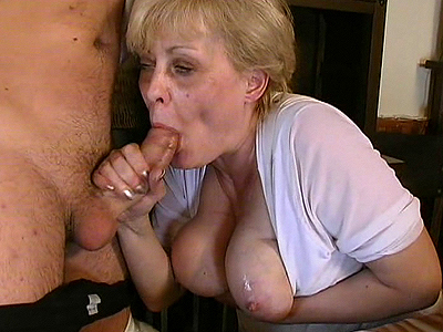Busty granny aids in blowjob