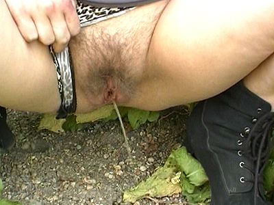 Busty lady pees outdoor