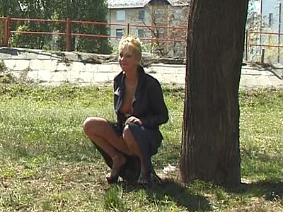 pretty blonde urinating on road