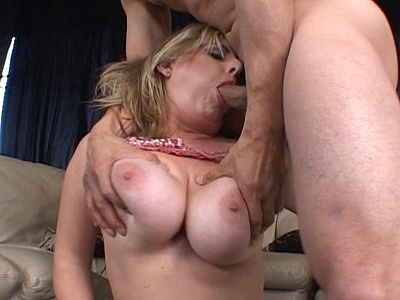 Blonde gal sucks dick and rubs it between her big voluptuous boobs!
