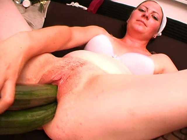 It is the time for some real extreme fuck for one horny house wife! After fucking shaved pussy with more carrots at once, the mature bitch uses a full glass in her vagina! What pleasures her the most are two cucumbers she fucks her cunt with same time, deeper and deeper!