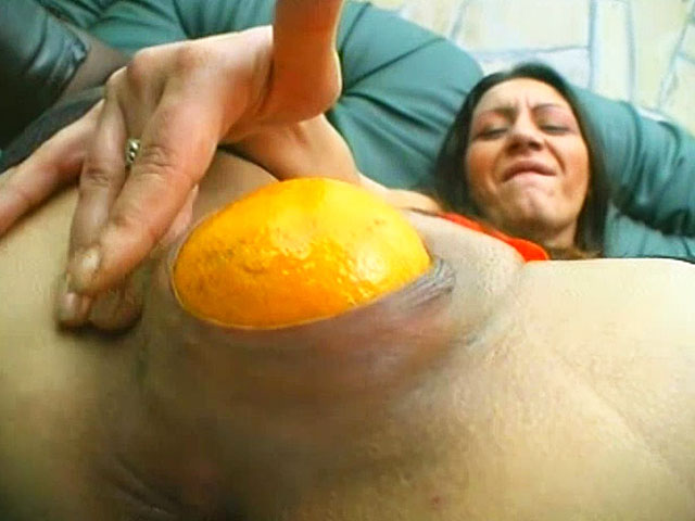 After sticking a thick glass as much as possible in her vagina, this brunette mature goes to fruits! She sticks an orange in nooky and fucks with it! While the orange is all inside the shaved pussy, the wild dame fucks her asshole with a carrot faster and faster!